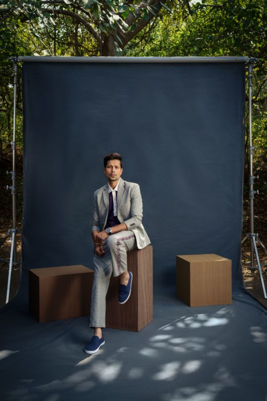 Suit and t-shirt by Lecoanet Hemant, Sneakers by Mulo and watch by Panerai.